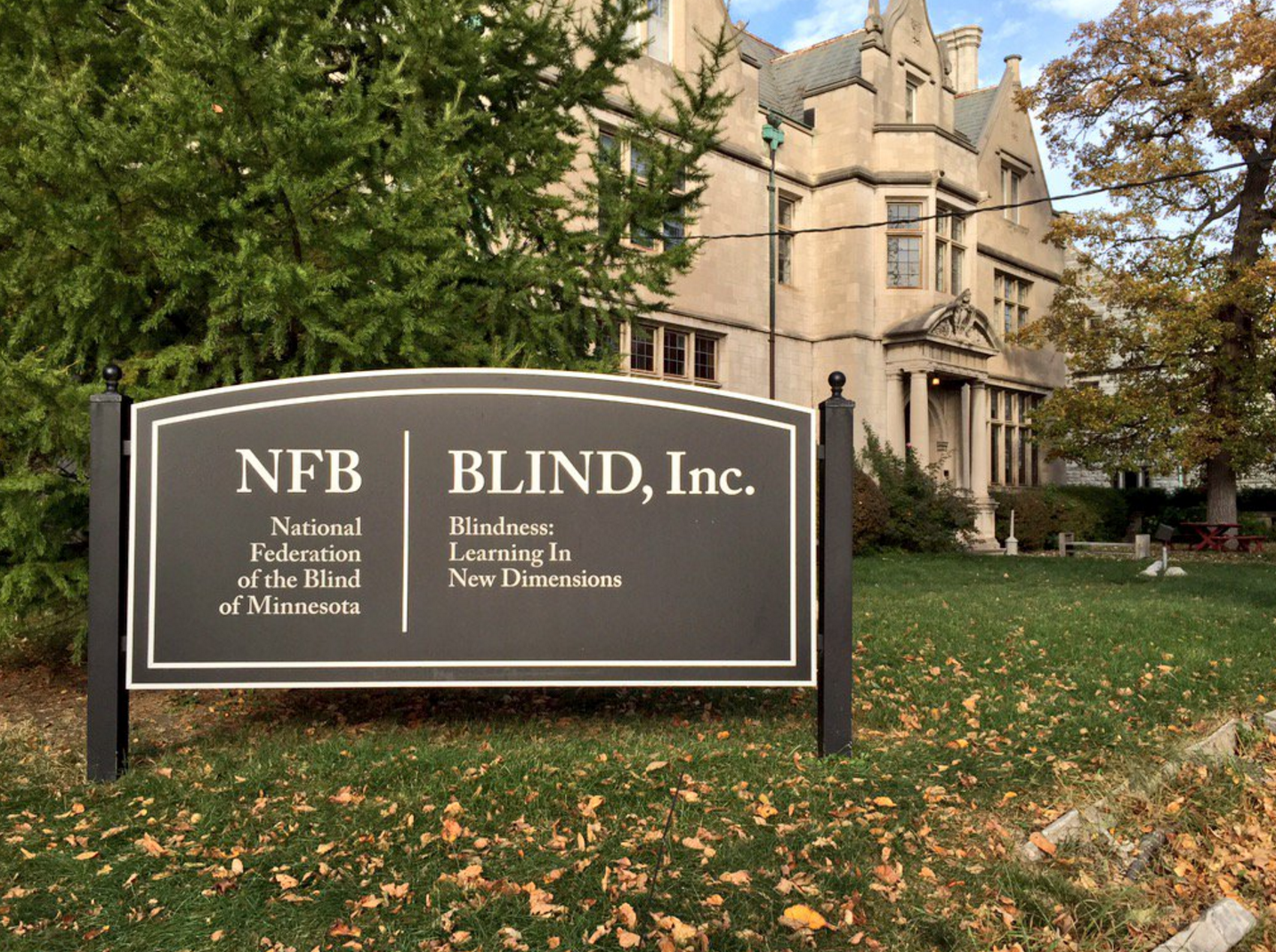 Image of the sign in front of BLIND, Inc.